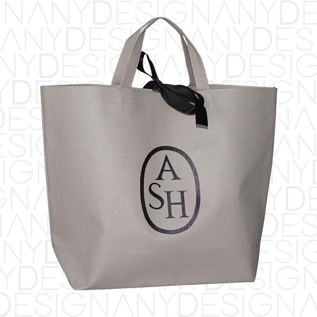Produzione shopping bag in TNT con laminazione effetto tela