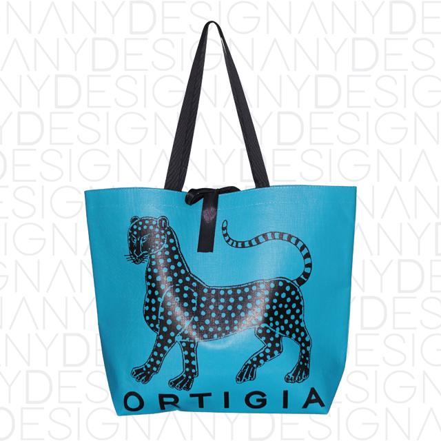 Produzione shopping bag in TNT laminato effetto tela e spalmatura colore